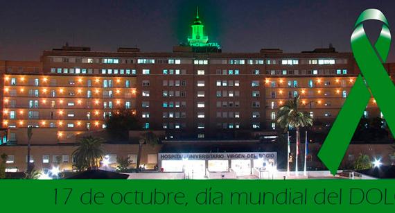 La cúpula del Hospital Virgen del Rocío se ilumina de verde por el Día Mundial contra el Dolor